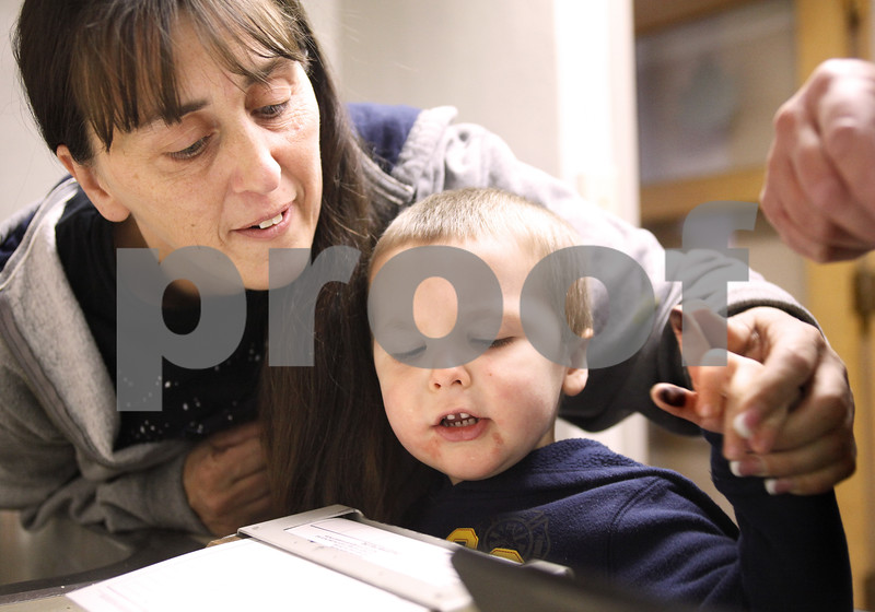 Kyle Bursaw – kbursaw@daily-chronicle.com<br /> <br /> Obie Garrison, 2, with the help of his grandmother Dawn Pinion, tries to make ink fingerprints as part of a 'DNA kit' children were making at an open house at the police department in the Village of Maple Park, Ill. on Saturday, Jan. 22, 2011.