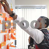 Kyle Bursaw – kbursaw@daily-chronicle.com<br /> <br /> During a group activity Bobby Love pulls vocabulary definitions off the whiteboard to match words he has at his seat during the 'Our Place' class at Kishwaukee College on Wednesday, Jan. 26, 2011.