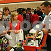 By ANDREW MITCHELL — amitchell@shawmedia.com<br /> Huntley Middle School students Jewel Marlow (left) and Savannah Long are shown a machine used by Hoffman Estates firefighter Tony Butler during the DeKalb High School Career Fair Thursday.
