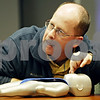 Rob Winner – rwinner@daily-chronicle.com<br /> <br /> Instructor Steve Kimmel demonstrates how to administer CPR on an infant with a manikin during a class at Community Coordinated Child Care in DeKalb on Monday evening.