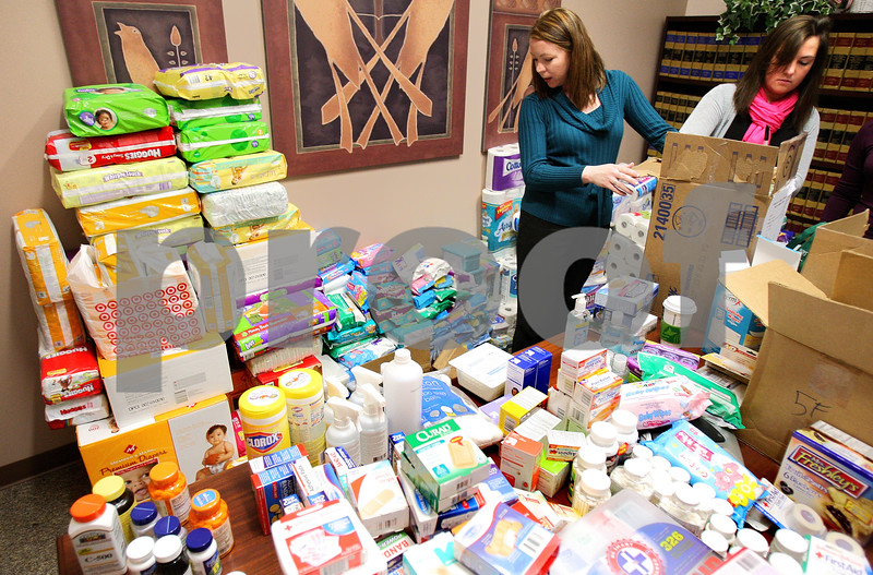 Kyle Bursaw – kbursaw@daily-chronicle.com<br /> <br /> Tracey Gallegos and Jenna Cooper (right) box up donations in a conference room at the Foster & Buick Law Group in Sycamore, Ill. on Tuesday, March 29, 2011.