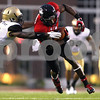 Kyle Bursaw – kbursaw@shawmedia.com<br /> <br /> Northern Illinois wide receiver Martel Moore (1) fights for extra yards as Army  defensive back Waverly Washington (21) tries to bring him down during the second quarter at Huskie Stadium in DeKalb, Ill. on Saturday, Sept. 3, 2011.