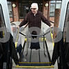 Kyle Bursaw – kbursaw@daily-chronicle.com<br /> <br /> Gladys Simon uses the lift to board one of TransVAC's 'door-to-door' vehicles as driver Chad Anderson operates the lift on the afternoon of Thursday, March 17, 2011.