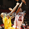 Rob Winner – rwinner@shawmedia.com<br /> <br /> Valparaiso forward Richie Edwards (0) fouls Northern Illinois forward Keith Gray (21) during a shot attempt in the first half on Tuesday, Dec. 20, 2011, in DeKalb, Ill.