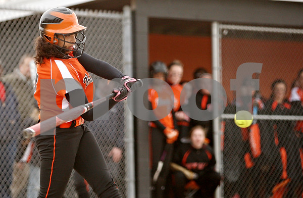 Rob Winner – rwinner@daily-chronicle.com<br /> <br /> DeKalb's Jessica Townsend drives in a run during the second inning on Tuesday, April 5, 2011, in DeKalb, Ill. DeKalb defeated Sycamore, 4-3.