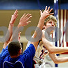 Rob Winner – rwinner@daily-chronicle.com<br /> <br /> Genoa-Kingston's Andrew Oplt takes a shot over two Somonauk defenders during the first quarter in Genoa, Ill. on Tuesday, Jan. 25, 2011.