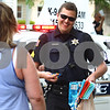 Kyle Bursaw – kbursaw@daily-chronicle.com<br /> <br /> Sergeant Robert Smith of the Genoa Police department hands out candy during the Genoa Days parade on Saturday, June 18, 2011.