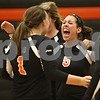 Rob Winner – rwinner@shawmedia.com<br /> <br /> DeKalb's Madison Lord (1) congratulates Kendall Baum after Baum's kill in the second game to secure the Barbs' victory against Kaneland in DeKalb on Thursday, Sept. 15, 2011. DeKalb defeated Kaneland, 25-17 and 28-26.