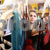 Kyle Bursaw – kbursaw@daily-chronicle.com<br /> <br /> Erin Kurilla, a volunteer at Project Prom and senior at NIU, arranges dresses on the racks during the event on Saturday, Feb. 19, 2011. Project Prom gives girls who may not be able to afford a dress a chance to find and try on outfits and take one home free of charge, the event is at Conexion Comunidad in DeKalb, Ill.