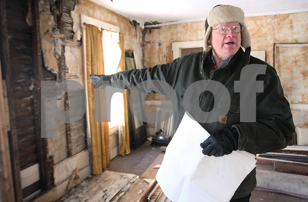 Kyle Bursaw – kbursaw@daily-chronicle.com<br /> <br /> James Hovis shows off different parts of the historic home at 315 N. Third Street in DeKalb where Isaac Ellwood once lived. Thursday, Feb. 10, 2011. Hovis once owned the house and the land, but it the land was recently purchased from him.<br /> <br /> Thursday, Feb. 10, 2011.
