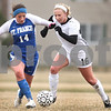 Kyle Bursaw – kbursaw@daily-chronicle.com<br /> <br /> Sycamore's Lindsey Hemmerich battles with St. Francis' no. 14 for the ball in the first half of the game at Sycamore high school on Tuesday, March 22, 2011.