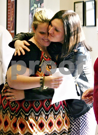 Nicole Weskerna – nweskerna@daily-chronicle.com<br /> <br /> Heather Wawak, director of the Ombudsman Learning Center in DeKalb, hugs Faith Coulter, a student who graduated from the program, during a recognition ceremony at the center on Friday, June 3, 2011.
