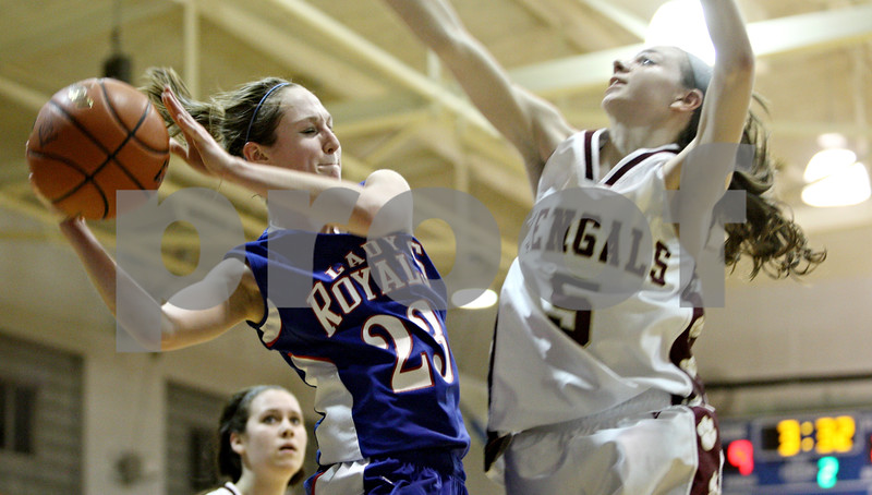 Rob Winner – rwinner@daily-chronicle.com<br /> <br /> Hinckley-Big Rock's Alyssa Baunach fakes a shot and then goes to pass while Alexis Genge of St. Benedict defends during the second quarter of the IHSA Class 1A H-BR Sectional final in Hinckley, Ill., on Thursday February 17, 2011. Hinckley-Big Rock went on to defeat St. Benedict, 63-25.