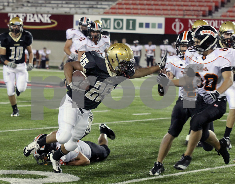 Wendy Kemp - For The Daily Chronicle<br /> Sycamore's Trent Greer (25) carries the ball during Friday's game against DeKalb at Huskie Stadium.<br /> DeKalb 9/9/11