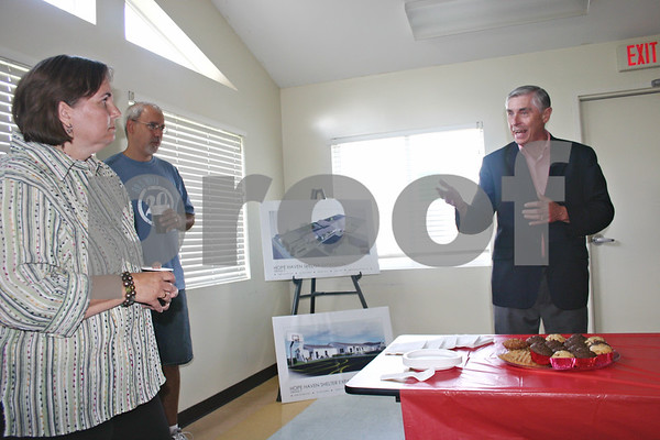 State Rep. Robert Pritchard, R-Hinckley (right), commends Lesly Wicks (left), executive director of Hope Haven, before the homeless shelter's groundbreaking ceremony Friday.<br /> By ANDREW MITCHELL — amitchell@daily-chronicle.com