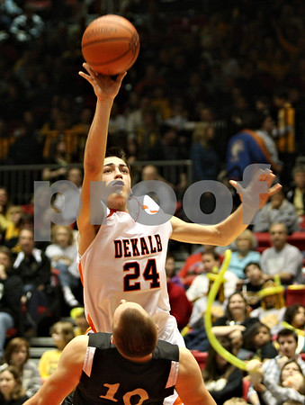 Rob Winner – rwinner@daily-chronicle.com<br /> <br /> DeKalb's Kyle Berg (24) is called for charging after colliding with Sycamore's Jordan Kalk during the second quarter of Friday night's game at the Convocation Center in DeKalb, Ill., on Friday, January 28, 2011.