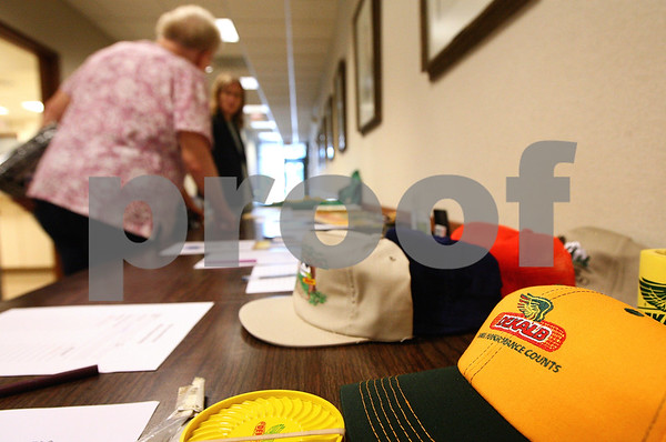 Kyle Bursaw – kbursaw@shawmedia.com<br /> <br /> Members of the DeKalb Alumni Association look at items in a silent auction, many of them with the DeKalb logo on it, during the group's  33rd anniversary meeting at the DeKalb County Farm Bureau in Sycamore, Ill. on Tuesday, Sept. 13, 2011.