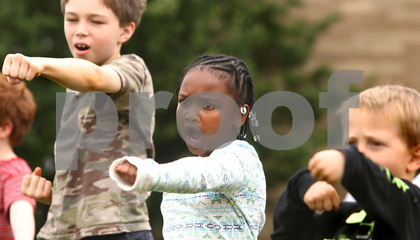 Kyle Bursaw – kbursaw@daily-chronicle.com<br /> <br /> Taliah Griffin (center) and Dimitiri Taylor (left) do a series of punches during a course called 'ninja power' during the summer day camp at the Kishwaukee Family YMCA  on Friday, June 10, 2011.