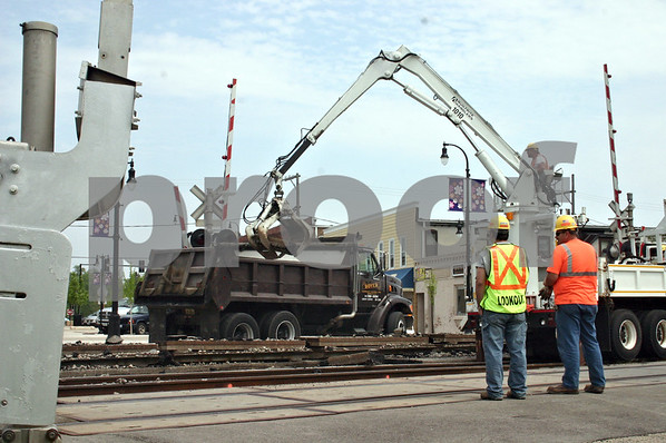 By ANDREW MITCHELL — amitchell@daily-chronicle.com<br /> Repair crews with the Union Pacific Railroad tear up the tracks at the South Second Street crossing Thursday, to repair an unexpected dip in the track. The crossing is expected to be closed until Wednesday.