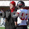 Kyle Bursaw – kbursaw@daily-chronicle.com<br /> <br /> Graduate assistant Joe Tripodi talk to players during practice at Huskie Stadium on Thursday, March 24, 2011.