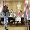 Rob Winner – rwinner@daily-chronicle.com<br /> <br /> Cortland resident Robert Butler looks for an empty booth before casting his vote at the Cortland Township Building on Tuesday afternoon.
