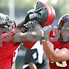 Rob Winner – rwinner@daily-chronicle.com<br /> <br /> Northern Illinois defensive end Cameron Clinton-Earl (left) blocks defensive tackle Ron Newcomb during practice at Huskie Stadium in DeKalb on Thursday.