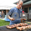 Kyle Bursaw – kbursaw@daily-chronicle.com<br /> <br /> Andrew Spyratos turns some pork shish kabobs he is cooking at Hopkins Park in DeKalb, Ill. on Saturday, June 25, 2011 during the Greek Food Festival put on by St. George Greek Orthodox Church.