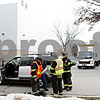 Rob Winner – rwinner@daily-chronicle.com<br /> <br /> Firefighters await the arrival of a hazmat removal team outside the 300 block of Eureka Street in Genoa after a hazardous material leak  on Wednesday afternoon.