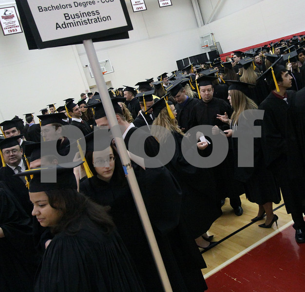 Wendy Kemp - For The Daily Chronicle<br /> Graduates gather before the graduation ceremony at Northern Illinois University on Sunday.<br /> DeKalb 12/11/11