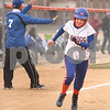 Kyle Bursaw – kbursaw@daily-chronicle.com<br /> <br /> Genoa-Kingston's Ashley Miller heads for home to give the Cogs their first run of the game against Ottawa in Genoa, Ill. on Wednesday, April 6, 2011.