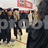 Wendy Kemp - For The Daily Chronicle<br /> <br /> Graduate Amanda Riego (right) takes a picture of her classmates (from left) Ariel Ray, Dacia Iverson and Jackie Robnett before the DeKalb High School graduation ceremony at the Convocation Center at Northern Illinois University on Saturday.
