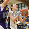 Rob Winner – rwinner@daily-chronicle.com<br /> <br /> Hiawatha's Cassie Lutz (right) looks to shoot, but is fouled by Serena's Karly Huss in the first quarter in Kirkland, Ill. on Monday December 6, 2010.