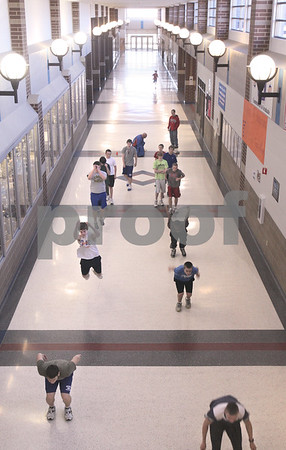 Kyle Bursaw – kbursaw@daily-chronicle.com<br /> <br /> The Genoa-Kingston track team warms up at the start of practice inside their school on Thursday, March 10, 2011.