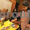 Wendy Kemp - For The Daily Chronicle<br /> Emma Cohen, 6, practices lighting the candles for Hanukkah at Congregation Beth Shalom on Sunday in DeKalb.<br /> DeKalb 12/18/11