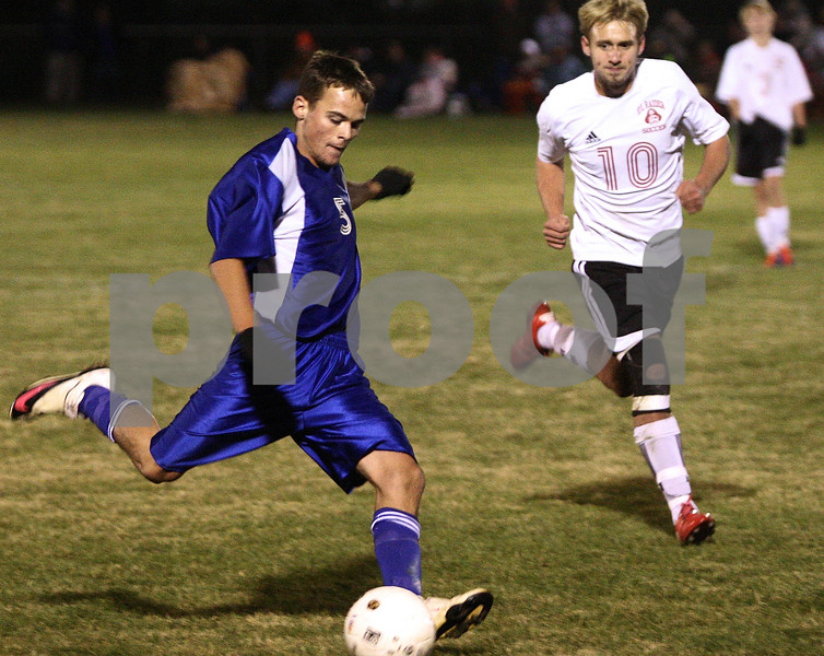 Rob Winner – rwinner@shawmedia.com<br /> <br /> Hinckley-Big Rock's Bernie Conley passes up to teammate Billy Weissinger who would go on to score the game-winning goal on Friday, Oct. 21, 2011 when the Royals defeated Earlville Leland, 2-1, to become the Class 1A Hinckley-Big Rock Sectional champs.