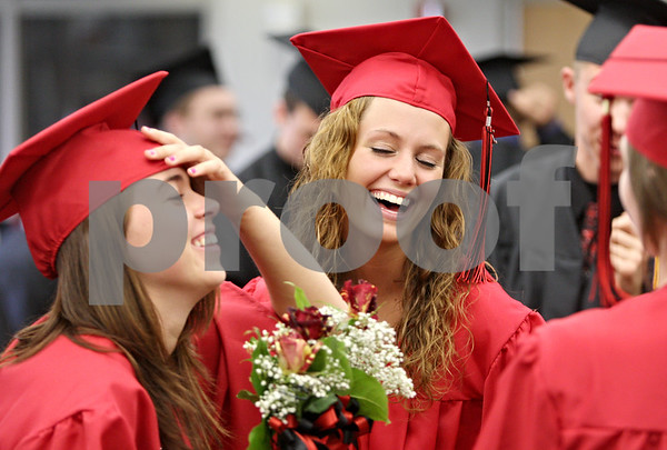 Rob Winner – rwinner@daily-chronicle.com<br /> <br /> Karissa Paku (left) and Hannah Bialas share a laugh among friends before the start of the Indian Creek High School commencement on Sunday, May 15, 2011, in Shabbona, Ill.