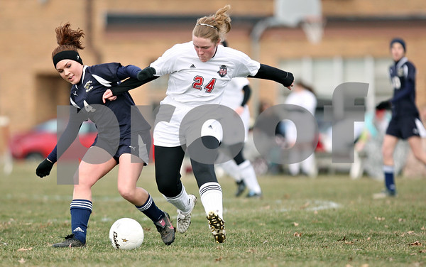 Rob Winner – rwinner@daily-chronicle.com<br /> <br /> Hiawatha's Cassie Lutz (left) and Indian Creek's Alex Cultra struggle for control during the first half of their game in Waterman, Ill., on Thursday, March 24, 2011. Hiawatha defeated Indian Creek, 3-1.
