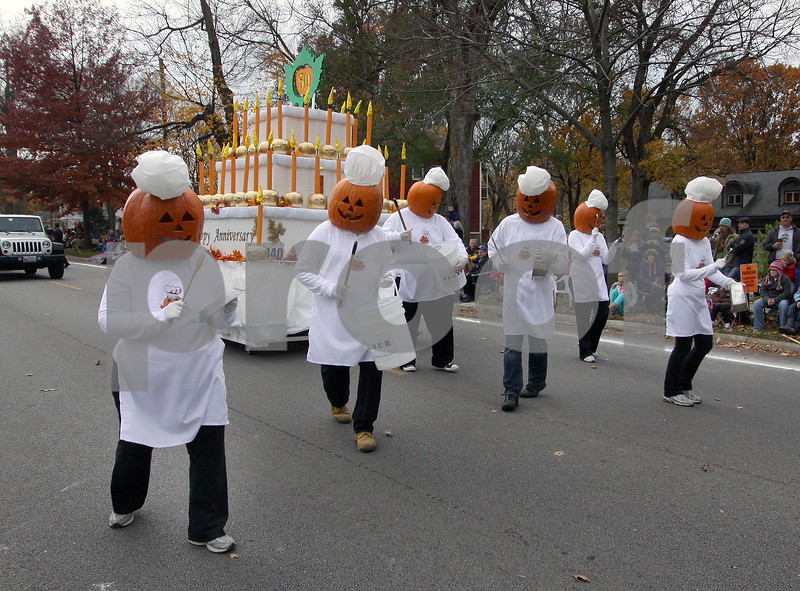 """Wendy Kemp - For The Daily Chronicle<br /> The Aldis Family celebrates """"50 Fabulous Years of Pumpkins"""" during in the annual Pumpkin Parade in Sycamore on Sunday.<br /> Sycamore 10/30/11"""