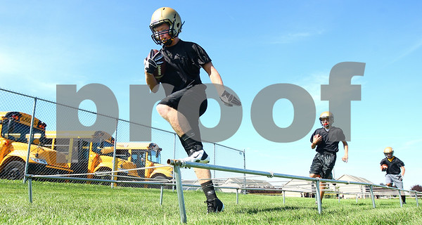 Kyle Bursaw – kbursaw@daily-chronicle.com<br /> <br /> Sycamore players do footwork drills during the first day of football practice Wednesday morning at Sycamore High School.<br /> <br /> Wednesday, Aug. 10, 2011.