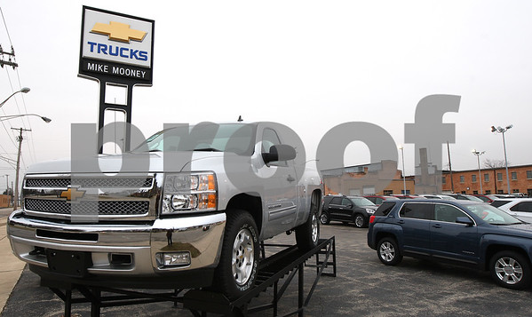 Kyle Bursaw – kbursaw@shawmedia.com<br /> <br /> The lot at the Mike Mooney dealership on Fourth street on Thursday, Dec. 22, 2011. The dealership has been sold to a new owner.