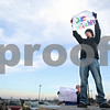 "Kyle Bursaw – kbursaw@daily-chronicle.com<br /> <br /> Jacob Sampson, a senior at Genoa-Kingston high school, holds a ""Save the Teachers"" sign while standing on top of a van in the high school's parking lot. Sampson and about two dozen other students walked out of school to protest teachers being dismissed due to budget issues in the school's parking lot on the morning of Tuesday, March 15, 2011."