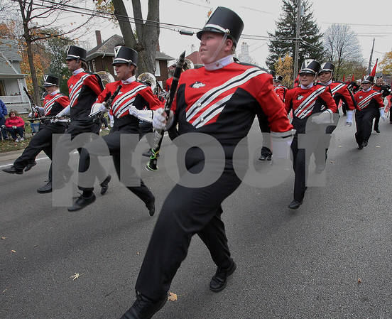 Wendy Kemp - For The Daily Chronicle<br /> The Northern Illinois University Marching Band dances down the street during the annual Pumpkin Parade in Sycamore on Sunday.<br /> Sycamore 10/30/11