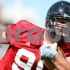 Rob Winner – rwinner@daily-chronicle.com<br /> <br /> Northern Illinois defensive tackle Ron Newcomb carries a football while practicing fumble recoveries during practice at Huskie Stadium in DeKalb on Thursday.