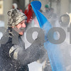 Kyle Bursaw – kbursaw@daily-chronicle.com<br /> <br /> Northern Illinois student Jared de Seife uses a sled as a shield during a snowball fight between students on campus on Wednesday, Feb. 2, 2011.