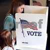 Kyle Bursaw – kbursaw@daily-chronicle.com<br /> <br /> Debbi Stevenson fills out a ballot as Haley Stevenson, 8, looks on at the Genoa Park district administrative building on Tuesday, April 5, 2011.