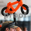 Kyle Bursaw – kbursaw@daily-chronicle.com<br /> <br /> Dean Okun of Chicago, sports a balloon hat in the shape of a bicycle, inside the Convocation Center during a reception for Bike MS: Tour de Farms participants on Friday, June 24, 2011.