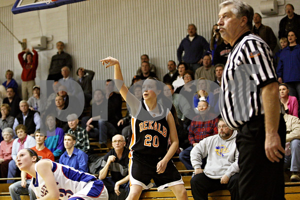 Rob Winner – rwinner@daily-chronicle.com<br /> <br /> DeKalb's Taylor White watches her shot drop to put the Barbs up 36-35 during the fourth quarter.