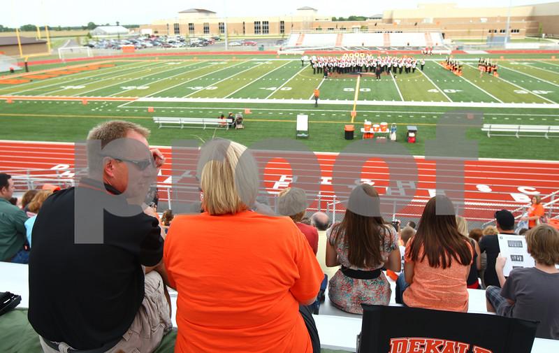 Kyle Bursaw – kbursaw@shawmedia.com<br /> <br /> DeKalb alumni Dean Bourdages and Sue Klatt chat as the marching band performs during the DeKalb High School Dedication Ceremony on Friday, Aug. 26, 2011.