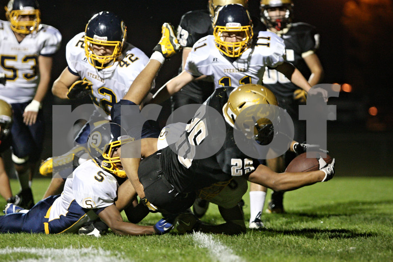 Rob Winner – rwinner@shawmedia.com<br /> <br /> Sycamore's Trent Greer crosses the goal line for a touchdown during the second quarter in Sycamore, Ill., on Friday, Sept. 23, 2011.