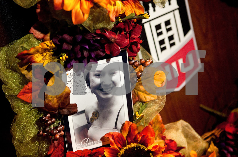 """Kyle Bursaw – kbursaw@shawmedia.com<br /> <br /> A wreath for Antinette """"Toni"""" Keller rests at the front of the podium at the memorial ceremony in her honor held at the East Lagoon put on by Huskies United in DeKalb, Ill. on Tuesday, Oct. 18, 2011."""